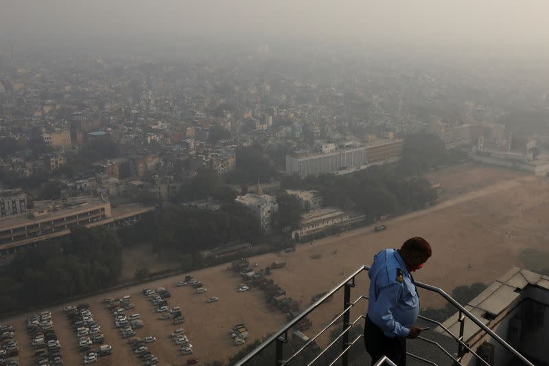 Buildings are seen shrouded in smog in New Delhi