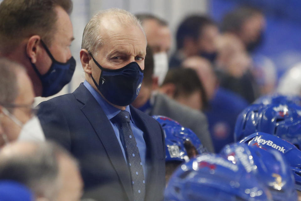 Buffalo Sabres head coach Ralph Krueger looks on during the first period of an NHL hockey game against the New York Islanders, Monday, Feb. 15, 2021, in Buffalo, N.Y. (AP Photo/Jeffrey T. Barnes)