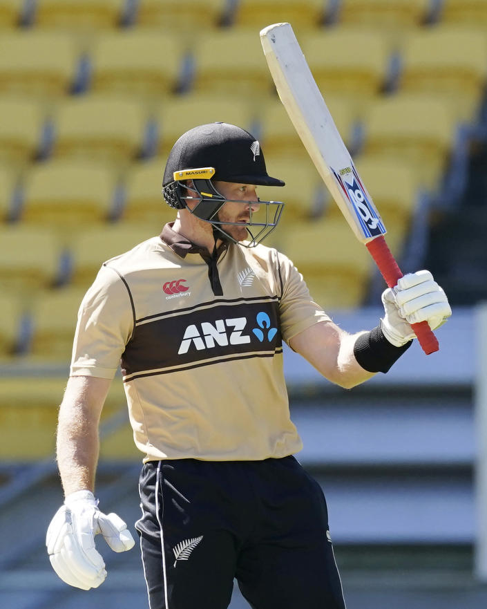 New Zealand's Martin Guptill celebrates 50 runs against Australia during their 5th T20 cricket international match at Wellington Regional Stadium in Wellington, New Zealand, Sunday, March 7 , 2021. (John Cowpland/Photosport via AP)