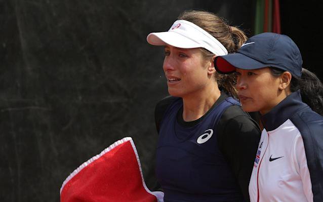 <span>Johanna Konta leaves the court in tears after Nastase's comments</span>