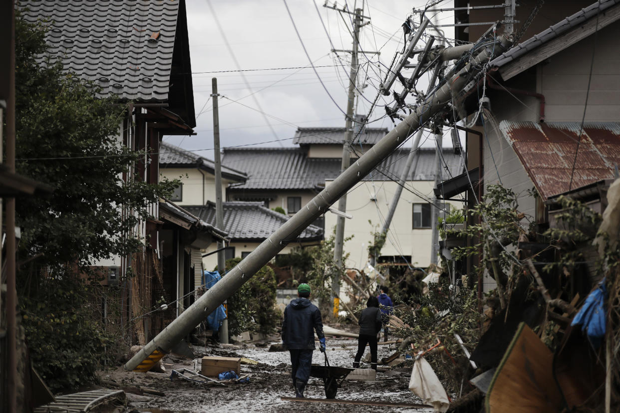 Residents walk along the mud-covered road in a neighborhood devastated by Typhoon Hagibis, Oct. 15, 2019, in Nagano, Japan. (Photo: Jae C. Hong/AP)