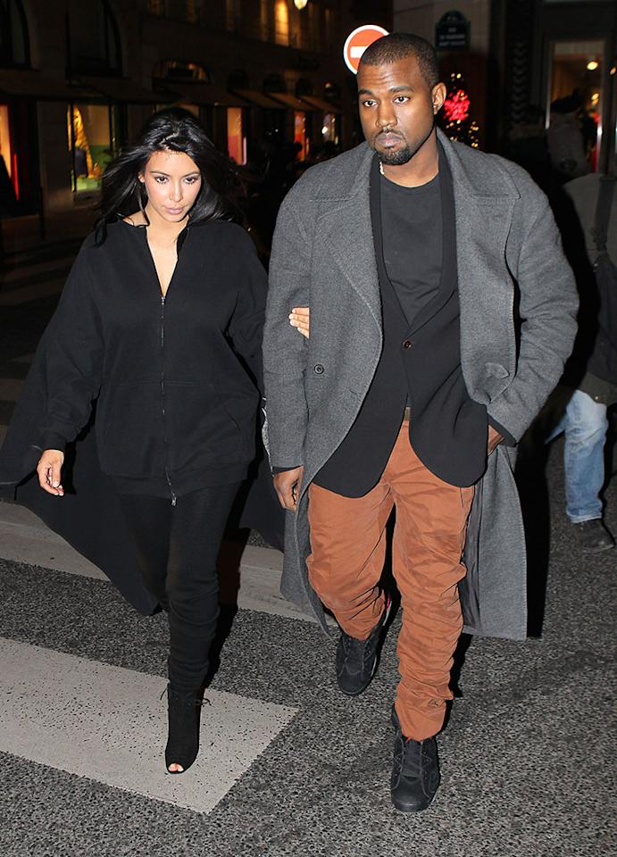 Kim Kardashian and Kanye West are in love in Paris, France. They shopped at Lanvin and Celine before having dinner at l'Avenue Restaurant. Pictured: Kim Kardashian and Kanye West  Ref: SPL479032  080113  Picture by: KCS Presse / Splash News   Splash News and Pictures Los Angeles:310-821-2666 New York:212-619-2666 London:870-934-2666 photodesk@splashnews.com