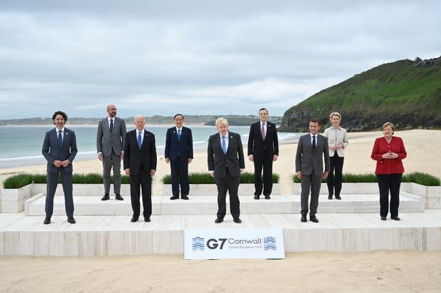 Social distancing was in evidence as the PM played host to the G7 gathering in Cornwall (Leon Neal/PA)
