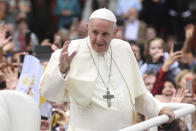 Pope Francis waves to the waiting crowds on College Green, Dublin, as he travels in the Popemobile during his visit to Ireland, Saturday, Aug. 25, 2018. (Joe Giddens/PA via AP)