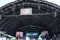 Workers continue preparing the NFL Draft Theatre for the 2021 NFL Draft, Tuesday, April 27, 2021, in Cleveland. After going all virtual in 2020 due to the COVID-19 pandemic, the three-day draft, which has grown into one of America's biggest, non-game sporting events, returns with thousands of fans who will be separated by their loyalties, and whether they've been vaccinated. (AP Photo/Tony Dejak)