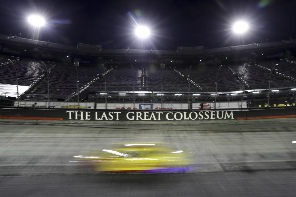 A car runs during a NASCAR All-Star auto race at Bristol Motor Speedway in Bristol, Tenn, Wednesday, July 15, 2020. (AP Photo/Mark Humphrey)