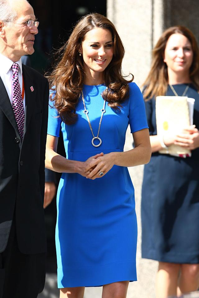 <p>People of the internet, we are now entering the tricky territory of the blue sheath dress. This one by Stella McCartney stops at the knees and has three-quarter sleeves. Kate wore this to the National Portrait Gallery. </p>