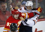 Edmonton Oilers' Darnell Nurse, right, fights with Calgary Flames' Sam Bennett during the first period of an NHL hockey game Saturday, Nov. 17, 2018, in Calgary, Alberta. (Jeff Macintosh/The Canadian Press via AP)
