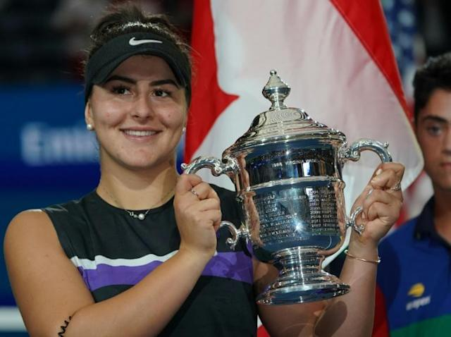 US Open champion Bianca Andreescu of Canada, posing with her trophy at Flushing Meadows, was honoured with a rally in her hometown of Mississauga (AFP Photo/TIMOTHY A. CLARY)