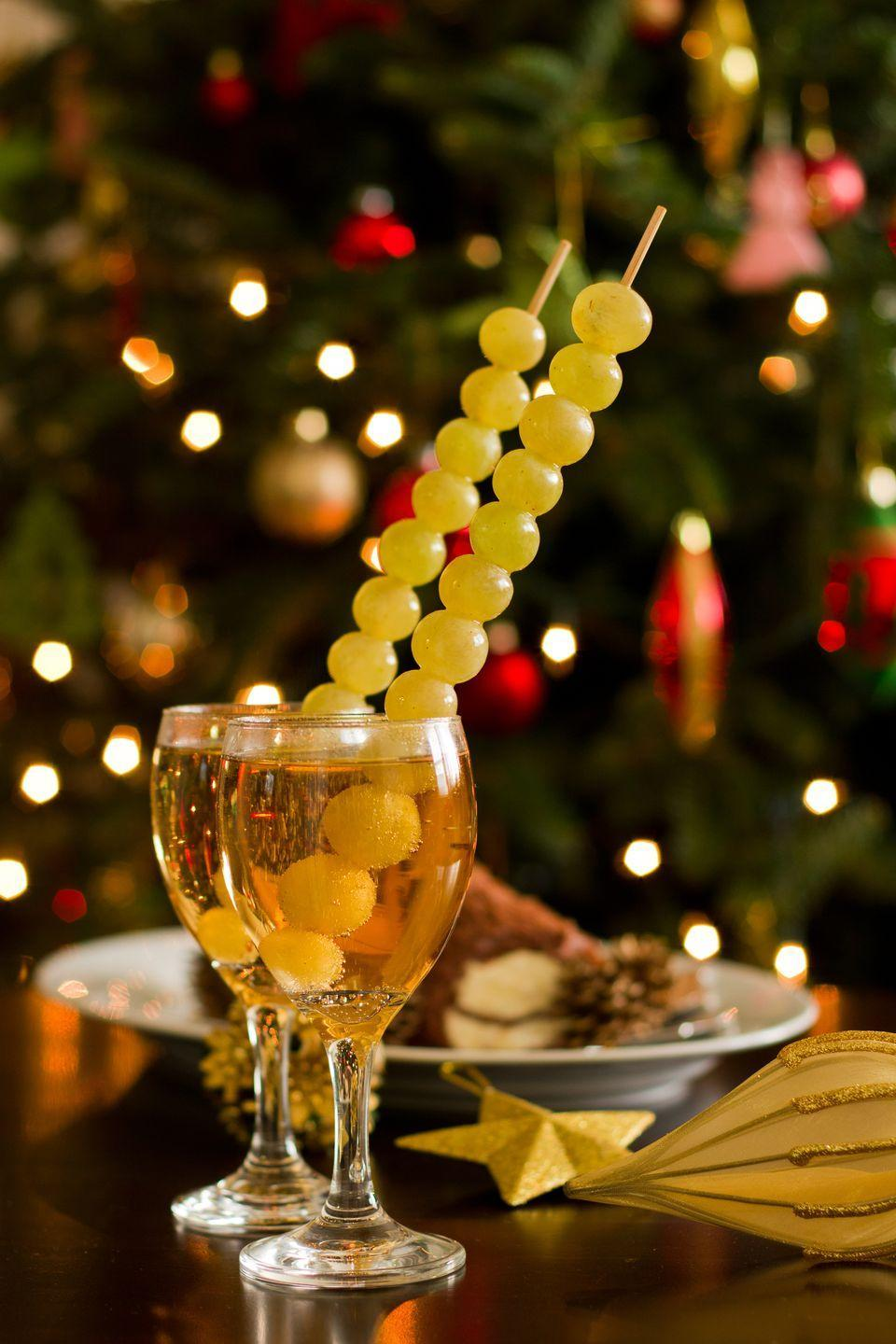"""<p>This food superstition that originated in Spain is meant to bring you luck for the year ahead. Just eat 12 grapes at midnight—one for every month—or put them on a skewer and serve as a fun <a href=""""https://www.countryliving.com/food-drinks/g2872/new-years-party-champagne-cocktails/"""" rel=""""nofollow noopener"""" target=""""_blank"""" data-ylk=""""slk:New Year's Eve cocktail"""" class=""""link rapid-noclick-resp"""">New Year's Eve cocktail</a> garnish.</p>"""