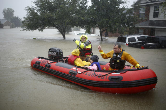 Rescuers help trapped residents escape from rising floodwaters in Spring, Texas, on Monday. (Photo: Luke Sharrett/Bloomberg via Getty Images)