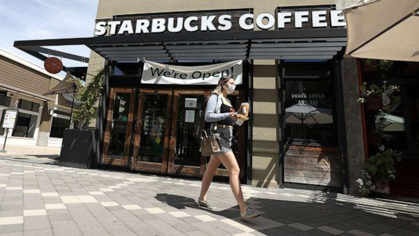 PHOTO: A customer walks by a Starbucks Coffee store, June 10, 2020, in Corte Madera, Calif. (Justin Sullivan/Getty Images)