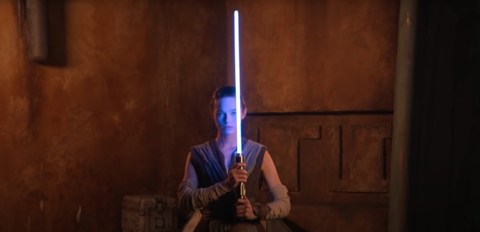 A still from a promotional video for Walt Disney World Resort's Star Wars: Galactic Starcruiser, which shows a working lightsaber in action (YouTube/Disney Parks)