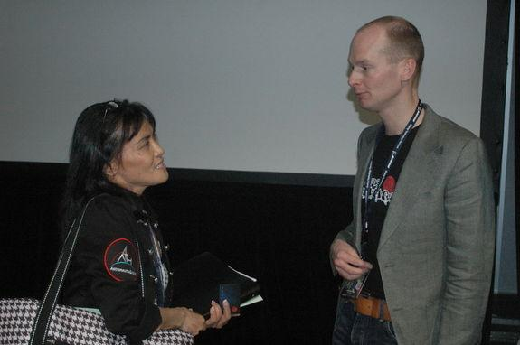 Mars One founder Bas Lansdorp discusses pressure suit technology with an MIT professor attending his talk at the Space Technology Expo.
