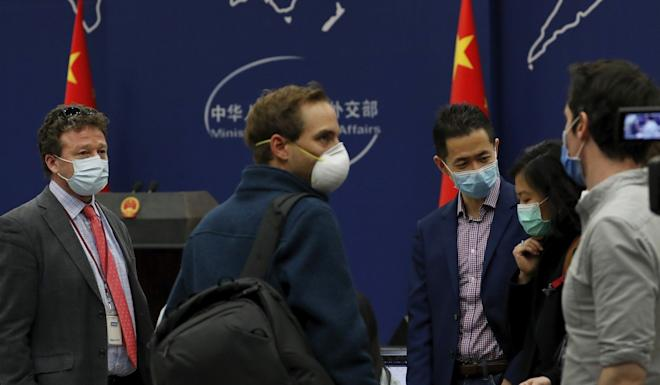 Foreign journalists chat after a briefing at China's foreign ministry on Wednesday. Photo: AP