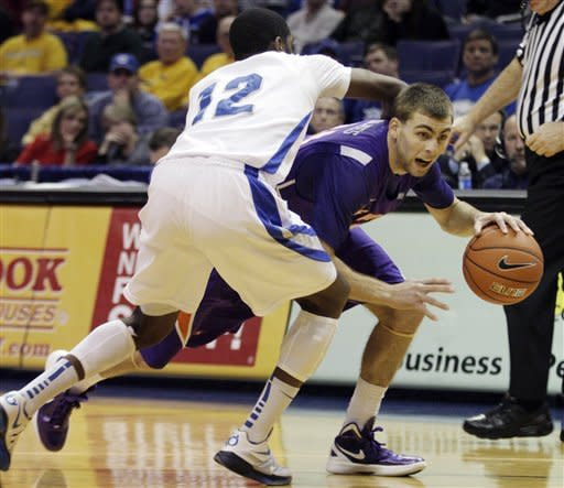 Evansville's Denver Holmes (34) drives past Creighton's Jahenns Manigat (12) in the first half of a Missouri Valley Conference tournament semifinal NCAA college basketball game, Saturday, March 3, 2012, in St. Louis. (AP Photo/Tom Gannam)