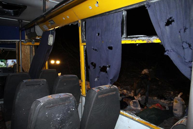 The interior of a damaged bus hit during shelling apparently aimed at a checkpoint manned by Ukrainian forces in Volnovakha, in the eastern Donetsk region, on January 13, 2015 (AFP Photo/Alexander Gayuk)