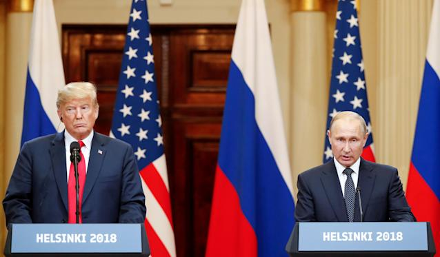 FILE PHOTO: U.S. President Donald Trump and Russian President Vladimir Putin hold a joint news conference after their meeting in Helsinki, July 16, 2018. REUTERS/Grigory Dukor/File Photo