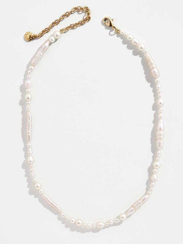 """<p><strong>BaubleBar</strong></p><p>baublebar.com</p><p><strong>$44.00</strong></p><p><a href=""""https://go.redirectingat.com?id=74968X1596630&url=https%3A%2F%2Fwww.baublebar.com%2Fproduct%2F48450-bolsena-strand-necklace&sref=https%3A%2F%2Fwww.cosmopolitan.com%2Fstyle-beauty%2Ffashion%2Fg35942347%2Fsummer-2021-jewelry-trends%2F"""" rel=""""nofollow noopener"""" target=""""_blank"""" data-ylk=""""slk:Shop Now"""" class=""""link rapid-noclick-resp"""">Shop Now</a></p><p>An updated version of your pearl necklace, trying layering with an initial necklace or your favorite charm pendant. </p>"""