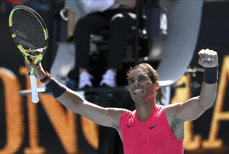 Spain's Rafael Nadal celebrates after defeating Bolivia's Hugo Dellien during their first round singles match at the Australian Open tennis championship in Melbourne, Australia, Tuesday, Jan. 21, 2020. (AP Photo/Lee Jin-man)