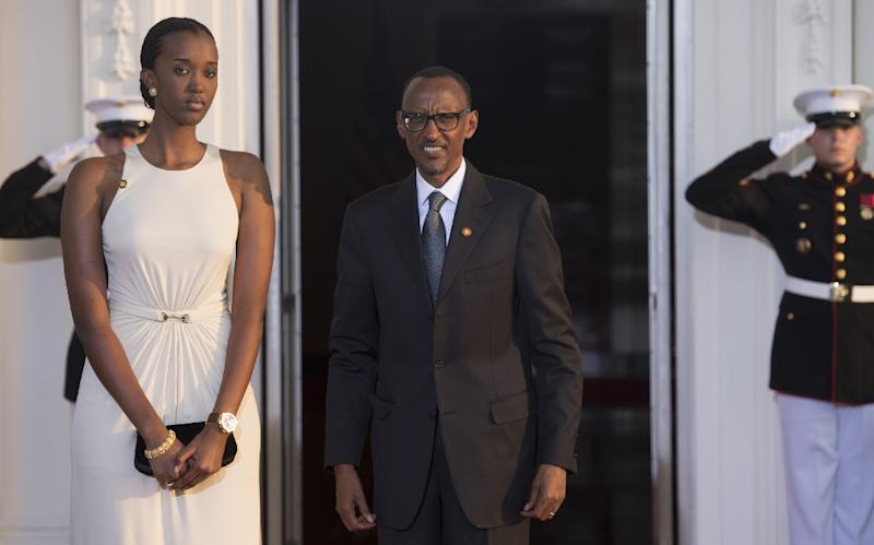 Rwanda President Paul Kagame and daughter arrive at the White House for a group dinner during the US Africa Leaders Summit August 5, 2014 in Washington, DC (AFP Photo/Brendan Smialowski)
