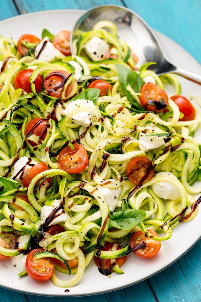 """<p>There's nothing like the fresh, crisp taste of a caprese salad. Bring those same beloved flavors over to your zucchini noodles using this recipe from Delish, which you can throw together in under 25 minutes for a refreshing and healthy lunch!</p><p><em><a href=""""https://www.delish.com/cooking/recipe-ideas/recipes/a47336/caprese-zoodles-recipe/"""" target=""""_blank"""">Get the recipe from Delish </a></em><em><a href=""""https://www.delish.com/cooking/recipe-ideas/recipes/a47336/caprese-zoodles-recipe/"""" target=""""_blank"""">»</a></em></p>"""