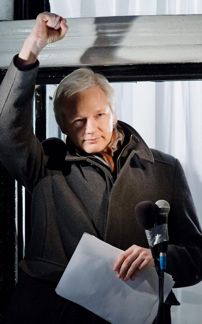 This file photo taken on December 20, 2012 shows Wikileaks founder Julian Assange gesturing as he addresses members of the media and supporters from the window of the Ecuadorian embassy in Knightsbridge