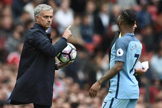 Manchester United's manager Jose Mourinho holds onto the ball as Manchester City's Raheem Sterling tries to retrieve it during their English Premier League match, at Old Trafford, on September 10, 2016 (AFP Photo/Oli Scarff)