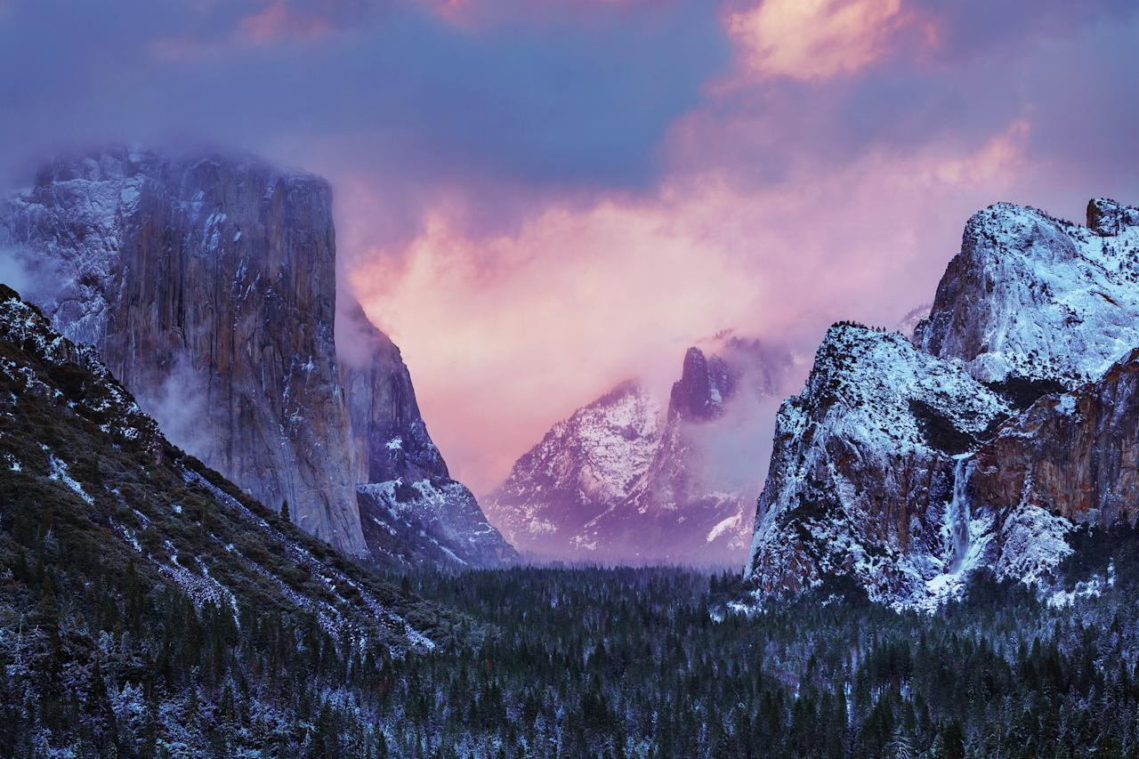 PIC BY NOLAN NITSCHKE / CATERS NEWS - (PICTURED Stunning landscape photography in Yosemite) This is the spectacular moment a photographer struck gold - by capturing a bolt of lightning cracking through a rainbow in a freak weather display. The extraordinary one-of-a-kind sighting was captured by keen photographer Nolan Nitschke, 27, while on a trip to Yosemite National Park in California, USA. Nolan knew a storm was approaching the area and that the incredible rocky peaks throughout the park act as lightning rods but had no idea he would capture such a breathtaking moment. After spending hours painstakingly trying for the perfect shot he finally hit the jackpot as the bright lightning crashed through the colourful rainbow lighting up the dark sky. SEE CATERS COPY