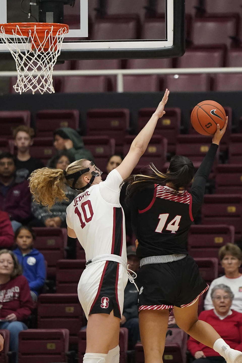 Stanford forward Alyssa Jerome (10) blocks a shot by Eastern Washington center Bella Cravens (14) during the first half of an NCAA college basketball game Tuesday, Nov. 5, 2019, in Stanford, Calif. (AP Photo/Tony Avelar)