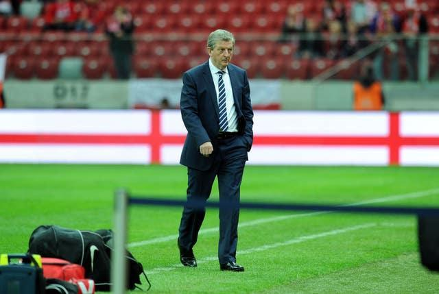 Roy Hodgson inspects the pitch before England's World Cup qualifier in Warsaw