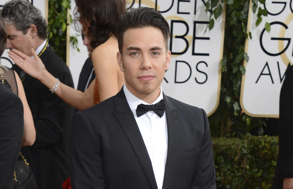 "FILE - Apolo Ohno arrives at the 71st annual Golden Globe Awards on Jan. 12, 2014, in Beverly Hills, Calif. Olympians including Michael Phelps, Ohno and Jeremy Bloom are opening up about their mental health struggles in a new sobering documentary about suicide and depression among the world's greatest athletes. Many of the athletes are sharing their pain for the first time in HBO's ""The Weight of Gold,"" which aims to expose the problem, incite change among Olympics leadership and help others experiencing similar issues feel less alone. (Photo by Jordan Strauss/Invision/AP, File)"