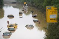 Submerged cars and other vehicles are seen on the federal highway B265 in Erftstadt, western Germany