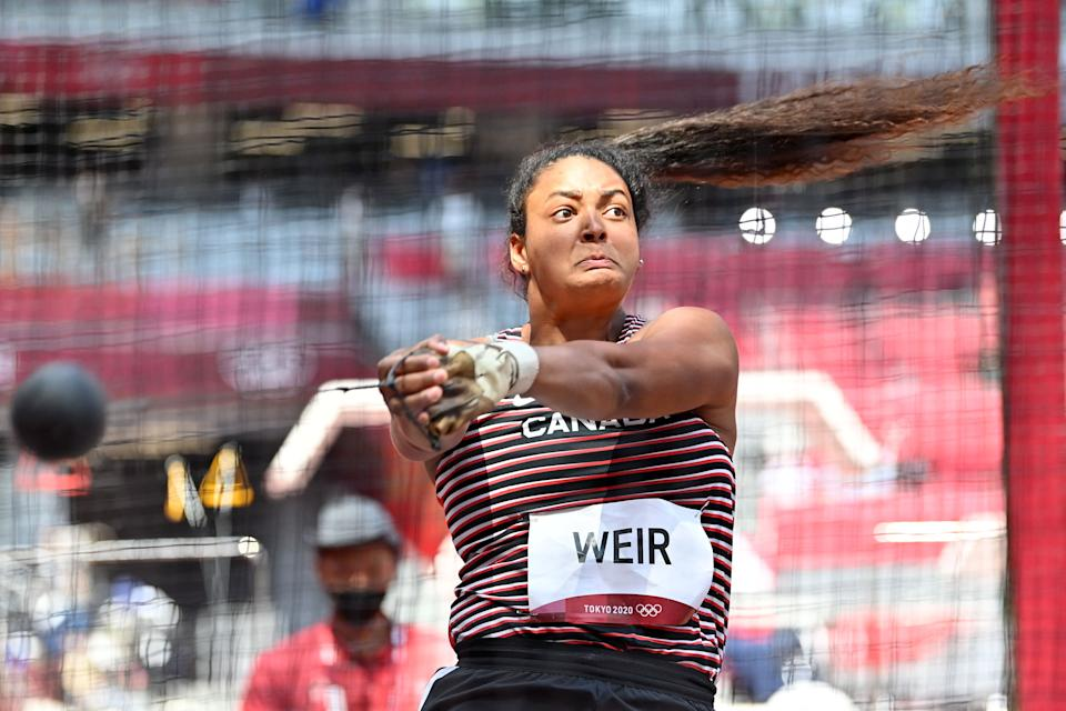 <p>Canada's Jillian Weir competes in the women's hammer throw qualification during the Tokyo 2020 Olympic Games at the Olympic Stadium in Tokyo on August 1, 2021. (Photo by Andrej ISAKOVIC / AFP)</p>