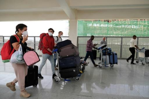 Foreign nationals were flying out of Nigeria's Abuja airport Sunday