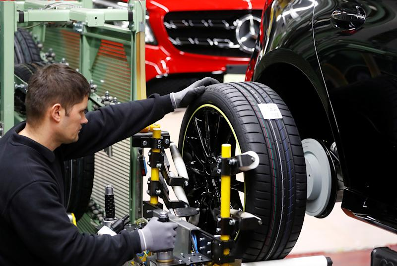 An employee of German car manufacturer Mercedes Benz installs wheels at a A-class model at the production line at the Daimler factory in Rastatt, Germany, February 4, 2019. REUTERS/Kai Pfaffenbach