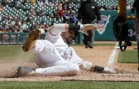 Detroit Tigers' Nicholas Castellanos safely slides to score on a single by teammate Miguel Cabrera during the fourth inning of a baseball game against the Chicago White Sox, Sunday, April 21, 2019, in Detroit. (AP Photo/Carlos Osorio)
