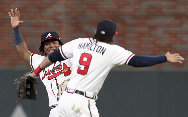 Atlanta Braves outfielders Ronald Acuna Jr., left, and Billy Hamilton celebrate after their win over the Washington Nationals in a baseball game Saturday, Sept. 7, 2019, in Atlanta. (AP Photo/Tami Chappell)