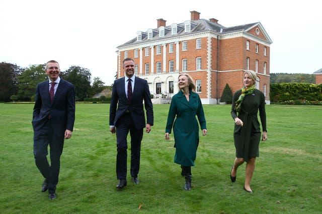 Liz Truss strolls through the grounds  of Chevening with the foreign ministers of the three Baltic states