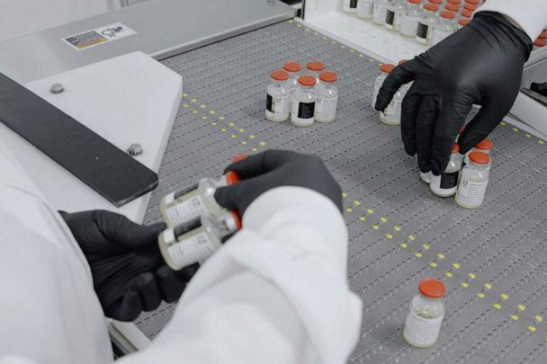 PHOTO: In this undated image from video provided by Regeneron Pharmaceuticals on Friday, Oct. 2, 2020, vials are inspected at the company's facilities in New York state, for efforts on an experimental coronavirus antibody drug. (AP)