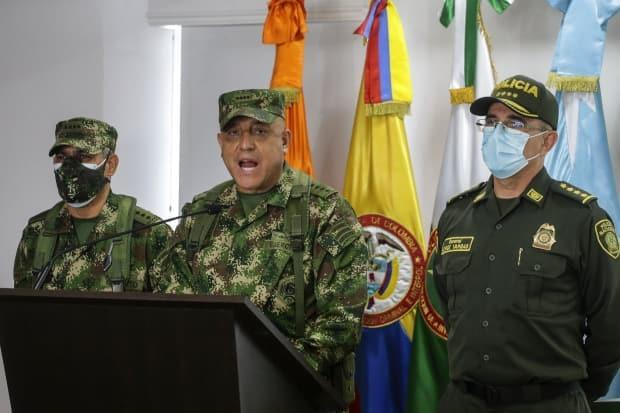 Colombian Armed Forces Commander Gen. Luis Fernando Navarro, centre, speaks to the media in Bogota on Friday about the arrest of 15 Colombians in connection with Haitian President Jovenel Moïse's assassination. (Ivan Valencia/The Associated Press - image credit)