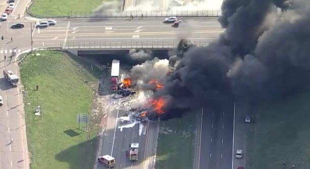 PHOTO: First responders battle flames after a fiery crash involving several cars and trucks on the eastbound lanes of Interstate 70 near Denver, April 25, 2019. (KMGH)
