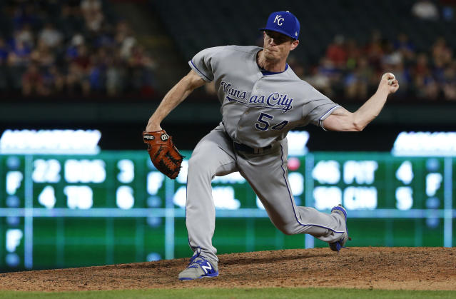 Kansas City Royals relief pitcher Tim Hill (54) delivers to a Texas Rangers batter during the eighth inning of a baseball game Thursday, May 24, 2018, in Arlington, Texas. (AP Photo/Ron Jenkins)