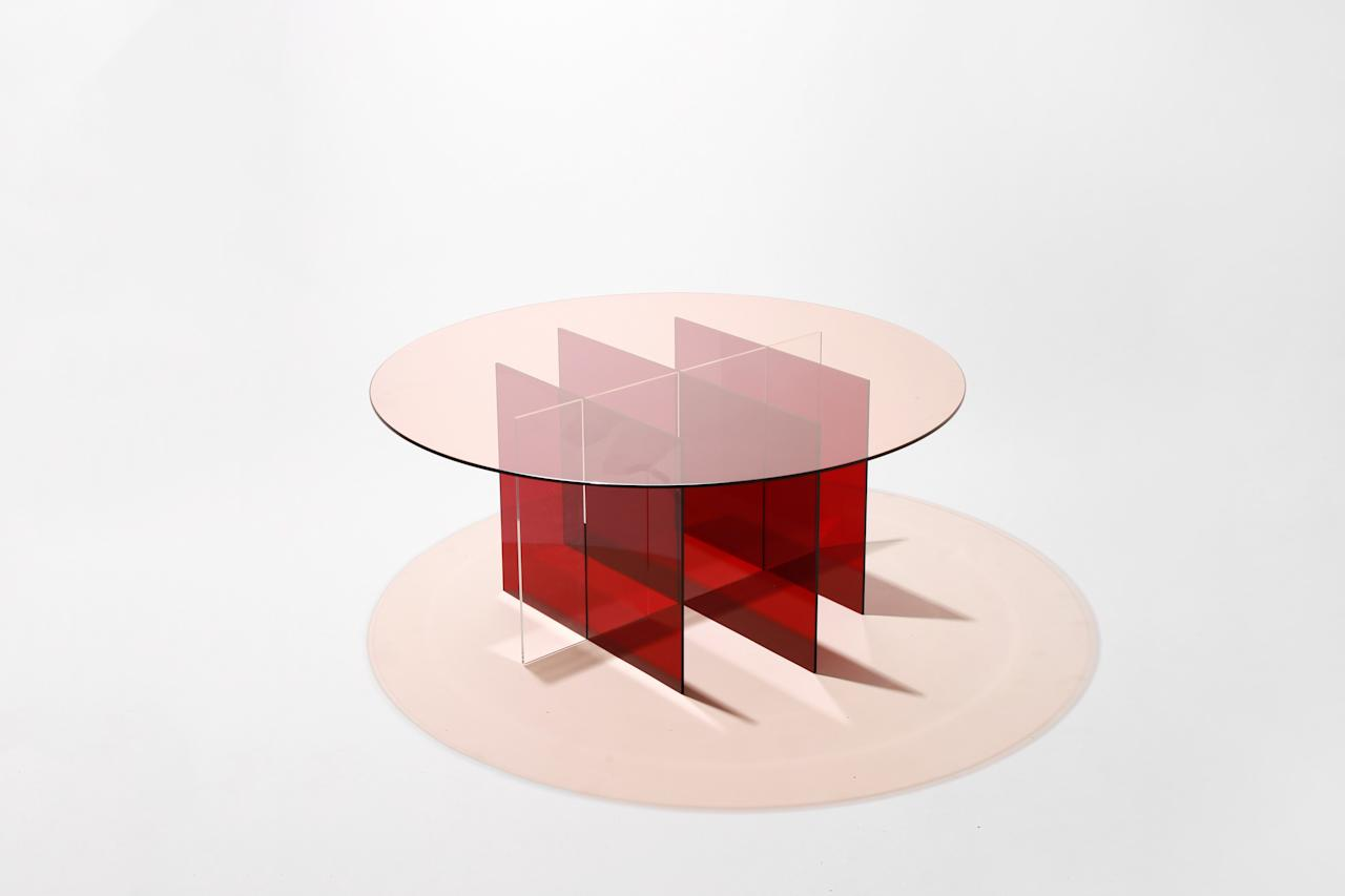 "Experimenting with light, shadow, and volume, this new table by Florida-based Yield Design changes in perceived volume depending on the angle you view it. Available in a variety of colors and with a glass or acrylic base, the piece can easily be taken apart to ship flat. <a href=""https://yielddesign.co/"">yielddesign.co</a>"