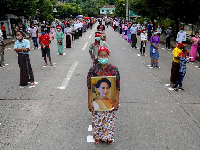 """People wear face masks and observe social distancing as they wait to enter the Martyrs' Mausoleum during a ceremony for Martyrs' Day in Yangon on July 19, 2020. <p class=""""copyright"""">SAI AUNG MAIN/AFP via Getty Images</p>"""