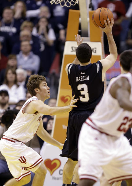 Butler guard Alex Barlow (3) shoots the game-winning shot over Indiana guard Jordan Hulls during the overtime period of an NCAA college basketball game in Indianapolis, Saturday, Dec. 15, 2012. Butler defeated No. 1 Indiana 88-86 in overtime. (AP Photo/Michael Conroy)