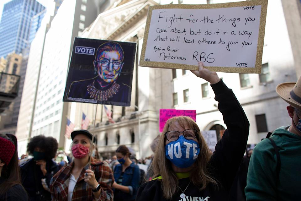 The late Justice Ruth Bader Ginsburg, whose seat Barrett has been nominated to fill, appeared on many signs on Saturday. (Photo: KENA BETANCUR via Getty Images)