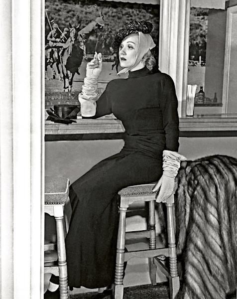 In this undated image released by Beverly Hills Collection, actress Marlene Dietrich is seen inside the Polo Lounge at The Beverly Hills Hotel. The Beverly Hills Hotel is celebrating its 100th Anniversary in May. (AP Photo/Beverly Hills Collection)
