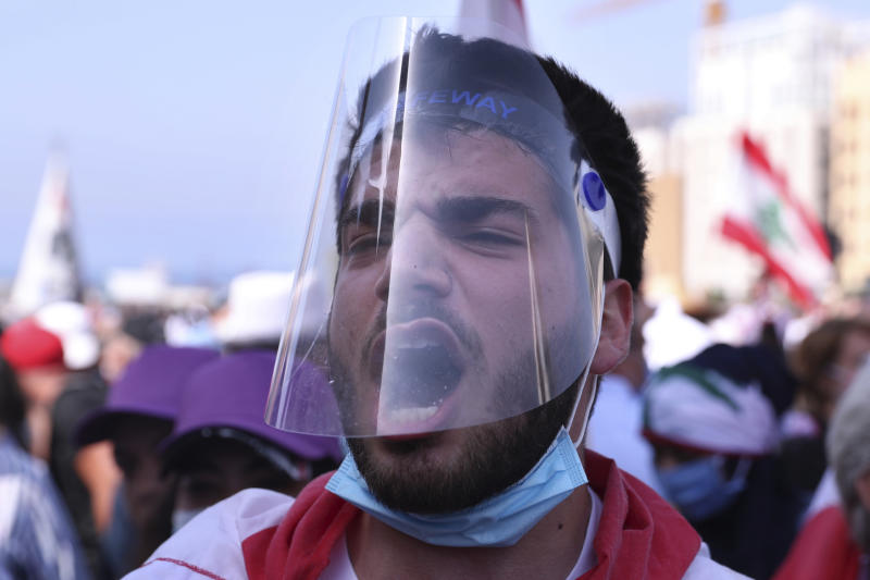 An anti-government protester shout slogans during a protest, in downtown Beirut, Lebanon, Saturday, June 6, 2020. Hundreds of Lebanese demonstrators gathered in central Beirut Saturday, hoping to reboot nationwide anti-government protests that began late last year amid an unprecedented economic and financial crisis. (AP Photo/Bilal Hussein)