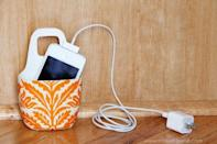 "<p>We're willing to bet your charging station is a disorganized mess, but there's a solution. Turn a bottle of baby lotion into a cell phone holder that hangs from the charger. Now, everything's in one place—and it's way more streamlined than a jumble of cables.</p><p>Get the tutorial at <a href=""http://www.makeit-loveit.com/2011/12/holder-for-charging-cell-phone-made-from-lotion-bottle.html"" rel=""nofollow noopener"" target=""_blank"" data-ylk=""slk:Make It & Love It"" class=""link rapid-noclick-resp"">Make It & Love It</a>.</p>"